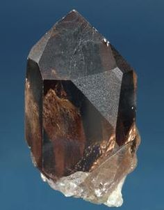 A small, clear smoky quartz crystal from the Val Giuv, Graubünden, Switzerland,