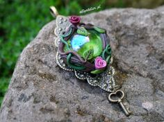 The secret garden collection. Handmade pendants made from polymer clay, glass and metal elements. All rights reserved.