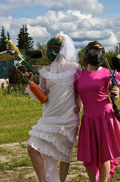 How's this for a great bachelorette party idea. Guests were instructed to wear the most hideous bridesmaid dress they could find, because it was time to get jiggy with some paintball guns!