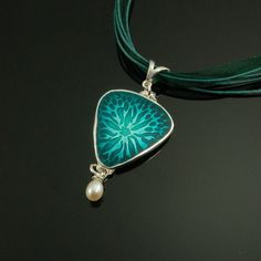 Blue Green Dream:  Fun with Basse Taille Enameling.  This peice made with ACS 650 Silver Clay and Soyer Leaded Enamels.