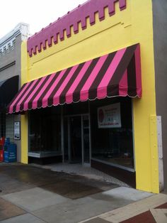 This cute awning adorns a bakery in NC. Custom awning made using brown and pink Sunbrella fabric.