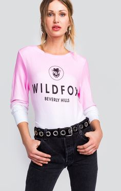 Every Wildfox adores Beverly Hills. The Baggy Beach Jumper has a relaxed, slightly oversized fit that hangs off the body perfectly. Scoop neck. Banded hems. Constructed from our deliciously soft Vintage Varsity fabric. Allover ombre print. In Flamingo Pink. 47% Rayon, 47% Polyester, 6% Spandex Model wears a size small
