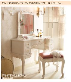 White antique style vanity table with pink chair from Romapri.