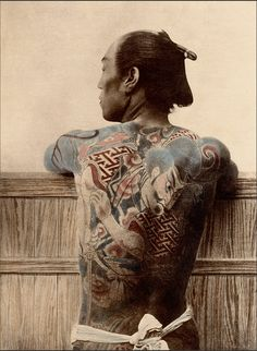 ABOUT THIS PHOTOGRAPH : PAYSAN TATOUÉ  Japan, about 1875.   The technique of traditional Japanese tattoo has several names, irezumi or horimono. Horimono refers to tattoo in general. However, irezumi is the term generally assigned to traditional tattoo covering large parts of the body, going as far as the typically Japanese 'integral tattoo', which covers the body like a second skin. Japanese tattoo patterns are influenced by traditional art, popular stories and religion.