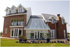 This Cheshire home features a large glass atrium incorporating Pilkington Activ™, benefitting from self-cleaning properties Conservatories, Atrium, Cleaning, Glass, Outdoor Decor, Home Decor, Homemade Home Decor, Drinkware, Home Cleaning