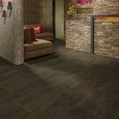 Photo features Copper Haze 12 x 24 field tile in a grid pattern on the floor.
