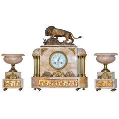 Exquisite Egyptian Revival Onyx Dore Bronze Clock after Bayre & Garnitures | From a unique collection of antique and modern clocks at https://www.1stdibs.com/furniture/more-furniture-collectibles/clocks/