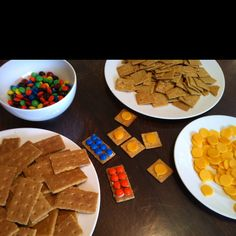Lego birthday party! Build your own Lego snack station! Graham crackers, dab of frosting plus M, and wheat thins with cheese circles! #legos