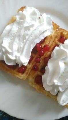 Waffles with whipped cream and red currents