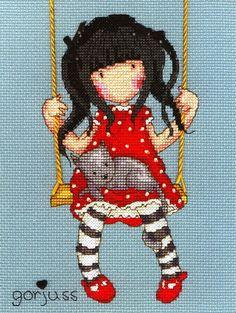 Девочка Горджусс (Gorjuss) — творение шотландской художницы Сьюзен Вулкотт (Suzanne Woolcott). Создана Горджусс была в 2005 году и сразу стала любимицей многих девочек и женщин. С её изображением стали выпускать открытки, канцтовары, модные женские и детские сумки, аксессуары, которые продаются более чем в сорока странах мира. Немного позже, одна из лондонских компаний разработала серию дизайнов…