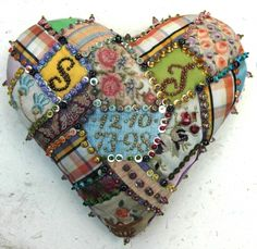 Patchwork heart...beads and sequins, not fancy stitches
