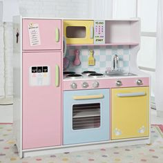 Have to have it. KidKraft Deluxe Pastel Play Kitchen $142.98  Wooden, not a bad price! So cute!