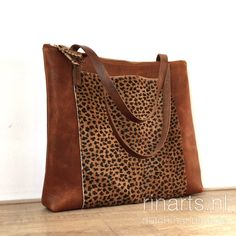 Cognac leather tote with leopard front pocket. Brown working bag with leopard cow hair detailing.