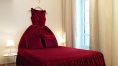 """Moschino Hotel - red dress bed...AwesOME idea for little girls' room - bedding/""""dress"""" in a whimsy print!!"""