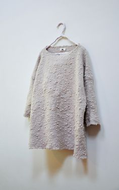 Amy Revier   Horn Pullover, tapestry-woven  hand felt angora wool available atDover Street Market)