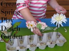 An imaginative and creative spring theme activity for the kids, creating a Spring Play Dough Garden. The play dough has been scented with a herbal shampoo to