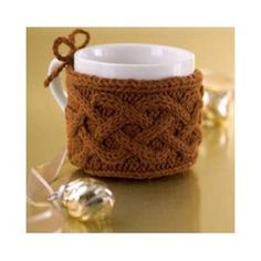 FREE Cabled Mug Cozy Knitting Pattern. Wrap it around a mug filled with chocolates and you're done!