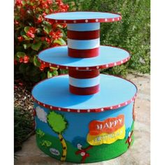 Dr. Seuss cake stand. Cake on top for him, cupcakes on bottom...hmm