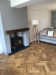 Cut down to and fitted parquet herringbone with s design strip in the border. All the corners in the border are mitred. Wooden Floors Living Room, Log Burner Living Room, Living Room Decor Fireplace, New Living Room, Open Plan Kitchen Dining Living, Dining Room, Lounge Decor, Lounge Ideas, Floor Design