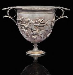 """A Roman parcel gilt silver """"skyphos"""" (a two-handled deep wine-cup on a low foot) circa late 1st century BC .-early 1st century A.D. (Christie's)"""