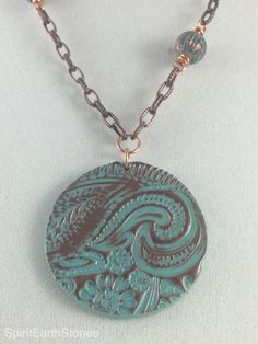A personal favorite from my Etsy shop https://www.etsy.com/listing/262417448/18-patina-polymer-clay-necklace-with