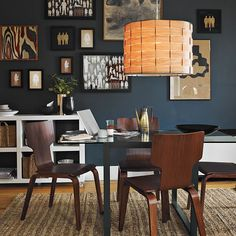 living space, wood chairs, woven drum light, dark paint