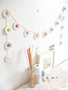 crochet nursery bunting in cream with rainbow dots, Ingrid penny garland, wall hanging - Ready To Ship, by Emma Lamb