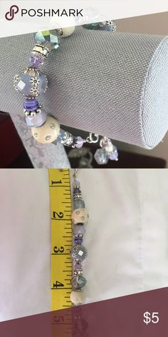 One of a kind handmade purple bracelet This is brand new never worn bracelet. This was hand made and is very pretty lilac and lavender purple colors. Has multiple length option on end. Beads by Brenda Jewelry Bracelets