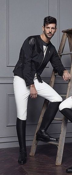 Looking good in white pants and tall boots, and ready to ride !