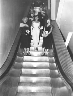 "Ladies standing on escalator at Halle's  Subject	Department stores  Halle Brothers Co.  Escalators  Description	""New Halle escalators, with Halle models riding them"" -- photo verso  Creator	Seid, Herman  Location Depicted	Downtown (Cleveland, Ohio)  Cleveland (Ohio)  Time Period	Post-Industrial: 1930-1959  Date Original	1951"