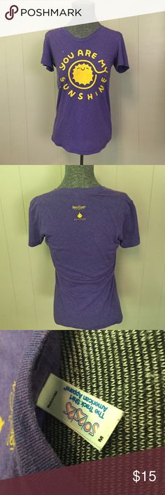"""""""You Are My Sunshine"""" Dirty Coast T-Shirt One time collaboration of Dirty Coast (NOLA) & Moonbot Studios (Shreveport). Awesome soft women's t-shirt in purple with Yellow """"You are my Sunshine"""" commemorating the Louisiana state song. T-shirt is size M, fitted, I usually wear a small, the M fits well without being too tight. T-shirt is """"the Track Shirt"""" by American Apparel"""" Dirty Coast Tops Tees - Short Sleeve"""