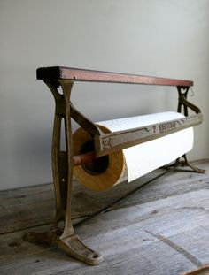 General Store Paper Cutter ~ I have a reproduction one of these (I think I got from Gooseberry Patch back in the day when they had products other than books).  I use it for paper towels.  Love it!
