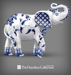Elephant figurine with symbolic Blue Willow china motifs. Handcrafted, with high-gloss finishes, simulated gemstone eyes.