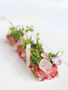 plate toro/ jalepeno mix on plate, micro greens, insert cornet with wasabi soy cream in center, pulvarize wasabi peas and nori flakes along edge of plate
