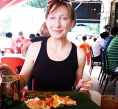 Eating Roti and Curry in a mamak stall in Malaysia. It's my favorite in the whole world.
