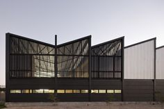 The Levering Trade headquarters with sawtooth roof in Zapopan, Mexico by ATELIER ARS° | Photo by Onnis Luque
