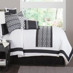 Black and white comforter set with a trellis motif. Includes two decorative pillows.    Product: 1 Comforter 1 Bedskirt