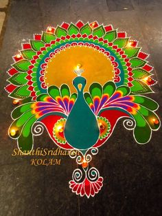 In search of the best Rangoli designs? Here's that well-curated roundup you were looking for! HappyShappy has tons of fresh ideas ranging from peacocks to dots to freehand. Here are the best ideas that are currently trending. Best Rangoli Design, Rangoli Designs Latest, Simple Rangoli Designs Images, Rangoli Designs Flower, Free Hand Rangoli Design, Rangoli Patterns, Colorful Rangoli Designs, Rangoli Ideas, Rangoli Designs Diwali