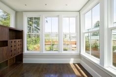 Those incredible windows!  This could make a great studio space for sewing and quilting.