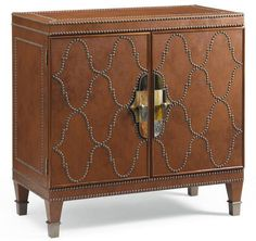 This studded leather console would be a stand out nightstand or a bar cabinet.