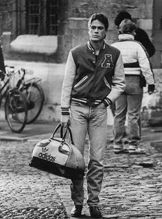 Black and white photo of Rob Lowe in Oxford Blues with Adidas bag and Letterman jacket Robe Lowe, Fashion Vector, Oxford Blue, Actrices Hollywood, Tumblr, Tennessee Williams, Fashion Flats, Man Crush, Jacket Style