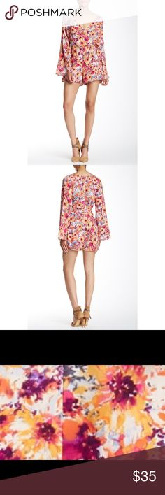 """2 HOUR SALE! Painted Threads Wrap Front Romper Beautiful Painted Threads romper with a modern fuchsia/pink all over floral print, wrap tie front & bell sleeves that give this modern romper a throwback retro edge. Features sexy deep V front with side tie detail, back zip closure, banded waist, & lining in the shorts. She'll: 100% rayon; lining 109% polyester. This is brand new without tags & in new condition! Per Nordstrom, this style runs true to size with a 3"""" inseam. Model is wearing a…"""