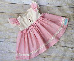 This spring pink dress with eyelet trim pink and color works perfectly for your Baby girls dress collection stunning for birthdays, Easter , family photos , church crochet trim and it buttons in the back . What little girl doesnt love to twirl around while being Comfortable enough for everyday, but pretty enough for any special occasion :)   6-12 ~ 13 inches  12-18 ~ 17 inches 24 months ~ 18  inches 2t~ 18 inches 3t~ 19.5 inches 4t~21 inches 5t~22  inches 6~23  inches 7~24 inches Have a…
