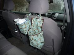 Want a stylish, custom fabric way to keep car tissues and trash/toys/travel necessities handy on the go? $25 for the set of Kaaachew car caddies on Etsy.com