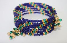 Hand beaded with small navy blue seed beads and emerald green crystals. This bracelet will stretch to fit anyone. Memory wire will keeps its shape for a lifetime with worn with care. Memory Wire Jewelry, Memory Wire Bracelets, Jewelry Bracelets, Wrap Bracelets, Beaded Jewelry, Handmade Jewelry, Unique Jewelry, Strand Bracelet, Diy Bracelet