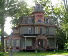 A neglected Painted Lady in Granville NY...one day the restoration just stopped...and now it sits uncompleted, unloved. hopefully someone will continue the work someday befored its forgotten forever.