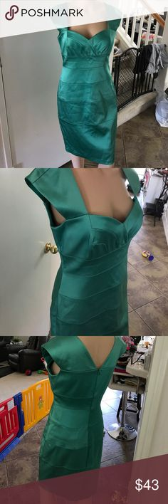 """Green cocktail dress Adorable on! The mannequin wearing it is 5'7"""" tall. Wears a size small. 34B chest. When I was going to put the dress the way I noticed a small spot on the left lower part of the leg. Very small highly noticeable. May come off when you dry clean it. Please check out my other items bundle and save. Would be great for a wedding or for prom. Dresses Prom"""