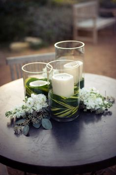 The outdoor tables will feature pillar candles in vases wrapped in ginger leaves.  The low tables will be trio with lavender stock flowers, and the tall tables will have a simple, single candle.