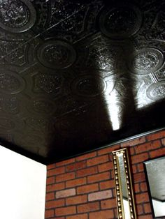 Mock tin ceiling -- embossed wallpaper painted a high gloss black