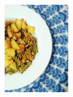 Rosemary Potatoes accompanied by green peas, garlic and pepper pasta. ...